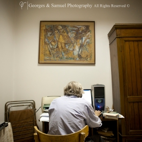 At 11:10 PM, Robert is working late typing final exams, a job that he has been doing for more than 40 years.